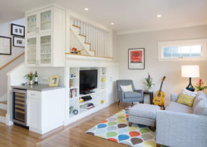 Small-space living room renovation with extra storage and wine bar