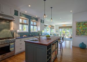 Modern farmhouse style for an open-concept kitchen remodel with butcher-block island.